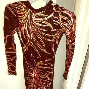 Red, black, gold sequined fitted jumpsuit
